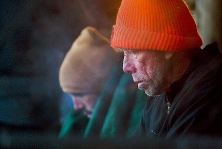 A homeless Myron Monken and another man (not wanting to be identified ) await wrapped in blankets outside the Ozanam Inn on Camp Street