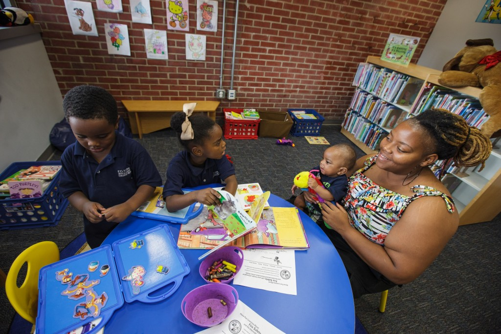 Trolean Tolliver at library with children